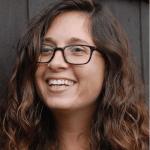 Lauren Sapala smiling in headshot