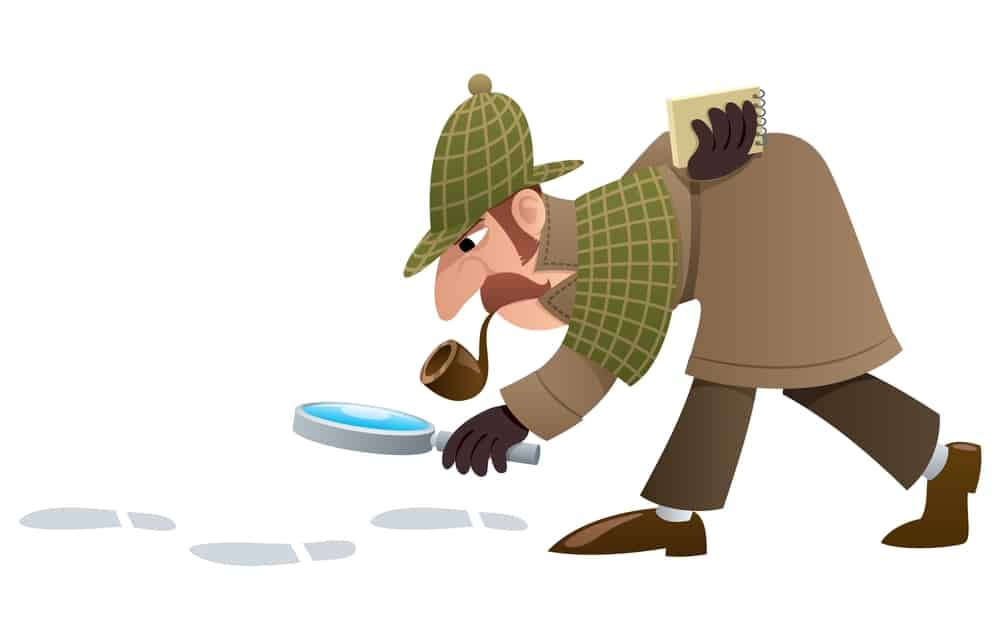 detective sleuth looking at footprints on the floor with a magnifying glass